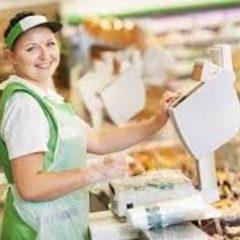 Продавець у магазин продуктів